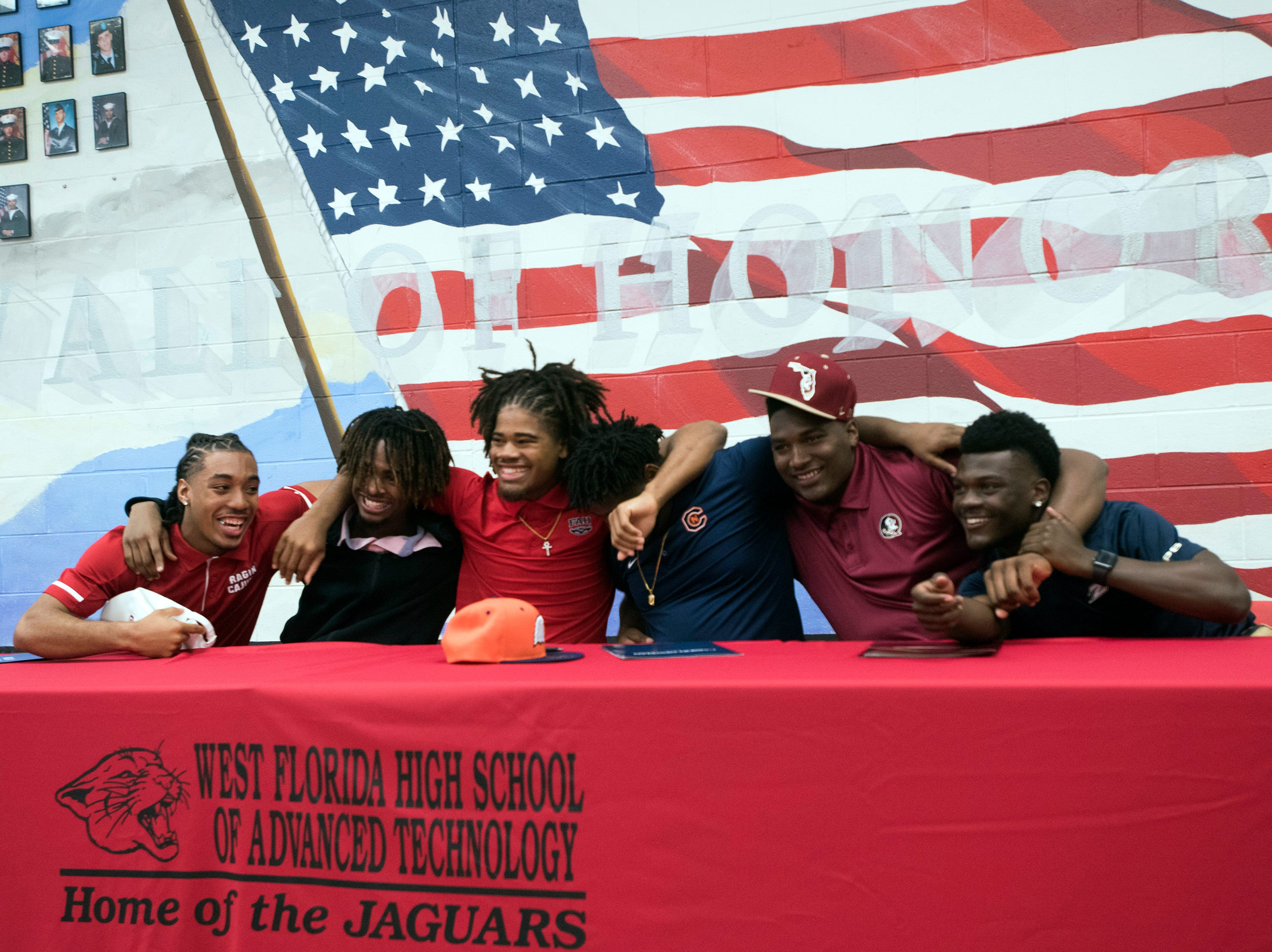The 2019 National Signing Day class at West Florida High School celebrates their accomplishments during a ceremony at the school on Wednesday, Feb. 6, 2019.