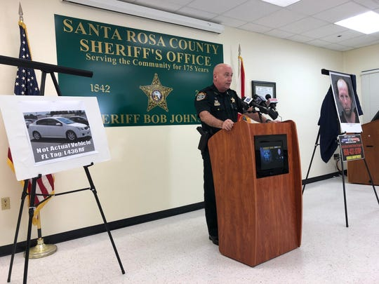Santa Rosa County Sheriff Bob Johnson holds a press conference Wednesday, Feb. 6, 2019, announcing a homicide after the body of a missing Navarre woman was found Tuesday, Feb. 5, 2019.