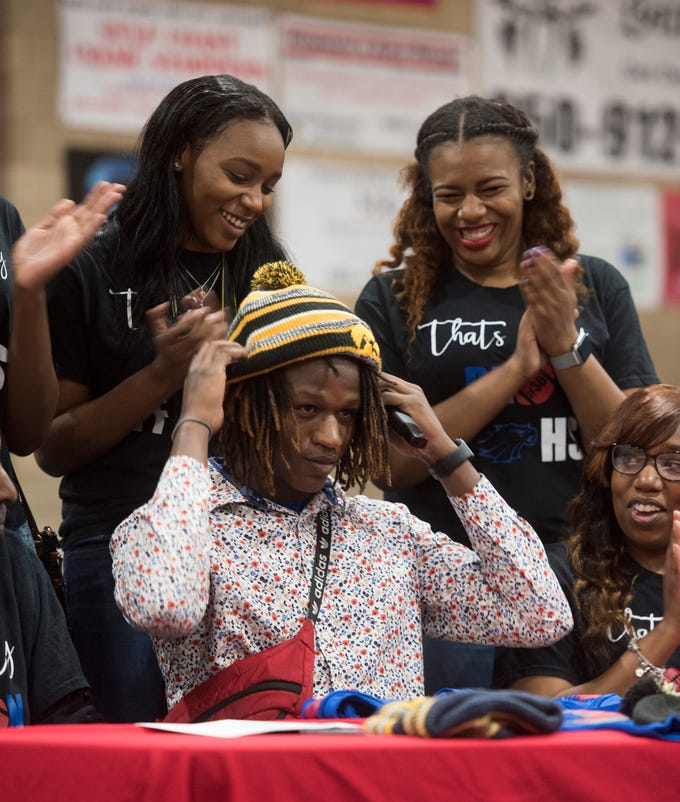 Pine Forest High School's TJ McCall commits to the University of Iowa on National Signing Day on Wednesday Feb.6, 2019, as his family and friends look on.