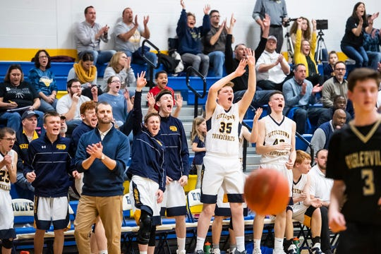 In this file photo, the Littlestown bench reacts after the Bolts drain a 3-pointer late in the fourth quarter of play against Biglerville Tuesday, February 5, 2019. The Bolts won 54-46 on senior night.