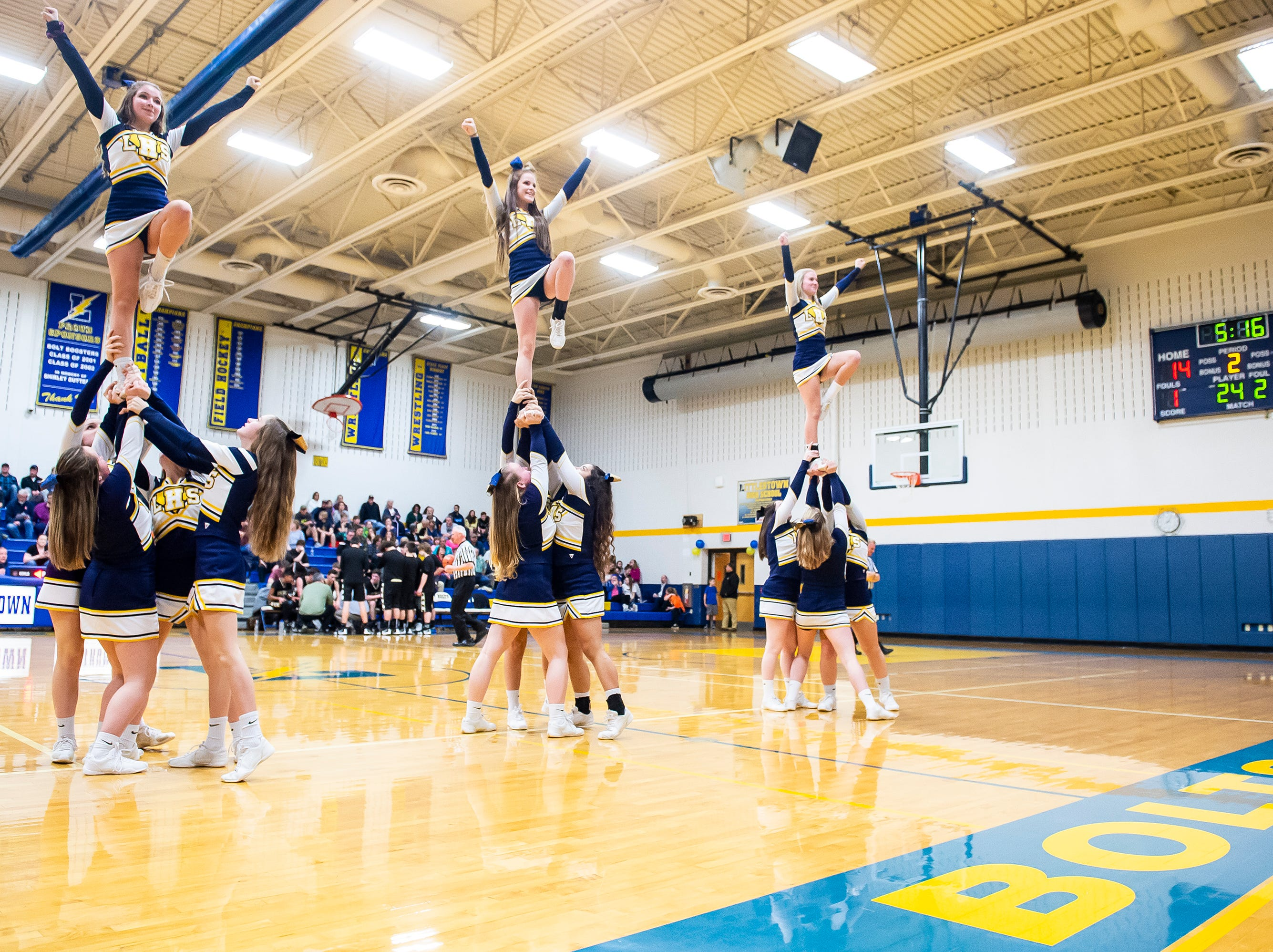 Littlestown cheerleaders perform a routine during a timeout between Biglerville and the Bolts Tuesday, February 5, 2019. The Bolts won 54-46 on senior night.