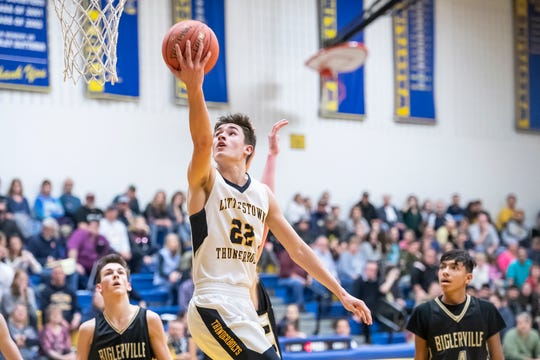 Littlestown's Logan Collins scores on a layup during play against Biglerville Tuesday, February 5, 2019. Collins lead all scorers with 26 points.