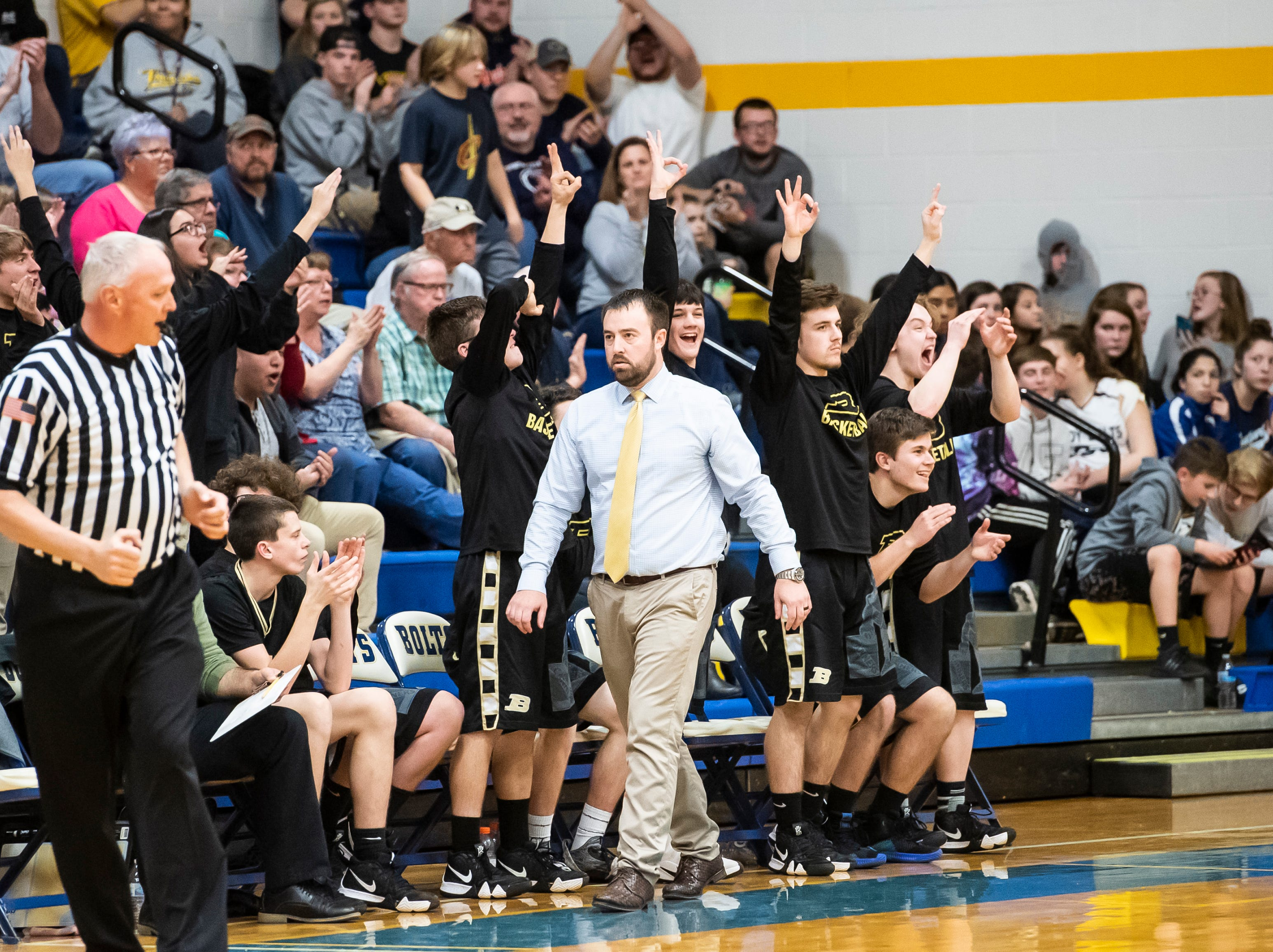 The Biglerville bench reacts after the Canners score a 3-pointer during play against Littlestown Tuesday, February 5, 2019. The Canners fell 54-46. .