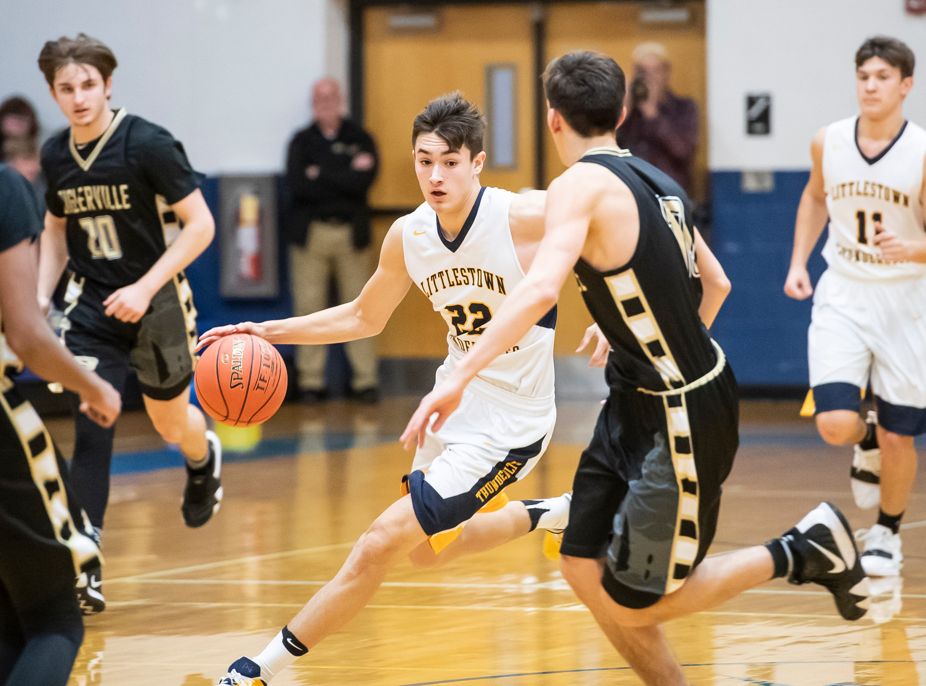 Littlestown's Logan Collins dribbles through traffic during play against Biglerville Tuesday, February 5, 2019. The Bolts won 54-46 on senior night.