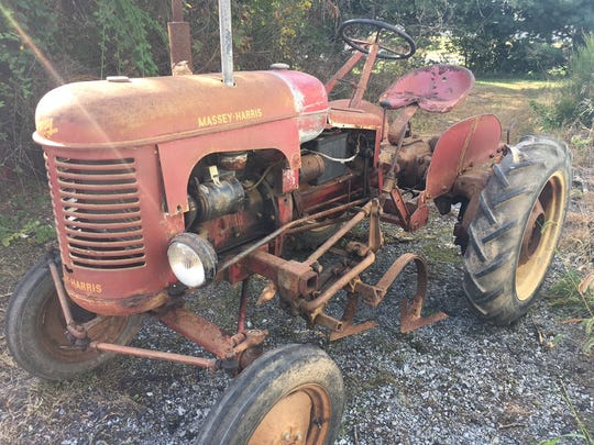 The 1949 Massey-Harris Pony tractor before restoration started.