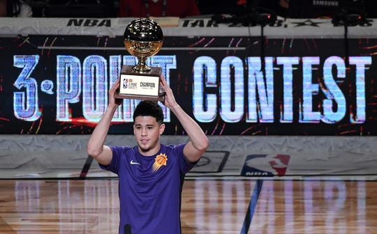 Feb 17, 2018: Phoenix Suns guard Devin Booker (1) holds the trophy after winning the three point challenge in the 2018 All Star Saturday Night at Staples Center.