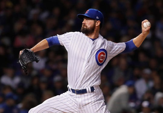 Cubs pitcher Cole Hamels throws a pitch against the Rockies during the 10th inning of the 2018 National League wild-card playoff game at Wrigley Field.