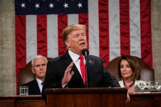 President Donald Trump gives his State of the Union address to a joint session of Congress, Feb. 5, 2019, at the Capitol in Washington, as Vice President Mike Pence, left, and House Speaker Nancy Pelosi look on.