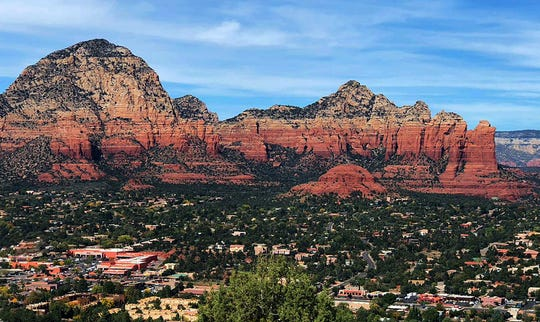 The view of Sedona from Airport Mesa. From left to right are Thunder Mountain, Sugarloaf and Coffee Pot Rock.