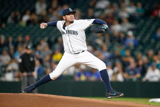 Mariners starting pitcher Felix Hernandez works against the Athletics during a game at Safeco Field.