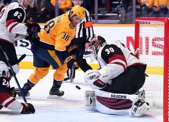 Feb 5, 2019; Nashville, TN, USA; Arizona Coyotes goaltender Calvin Pickard (30) makes a save on a shot by Nashville Predators right wing Ryan Hartman (38) during the first period at Bridgestone Arena. Mandatory Credit: Christopher Hanewinckel-USA TODAY Sports