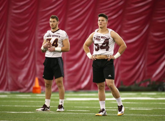 Arizona State Sun Devils linebackers Case Hatch (54) and (34) Kyle Soelle during spring football practice on Feb. 6 in Tempe.