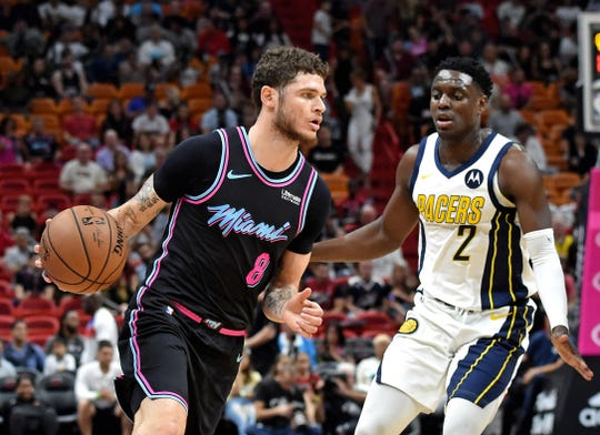 Tyler Johnson works against Pacers guard Darren Collison during the first half of a game at American Airlines Arena.