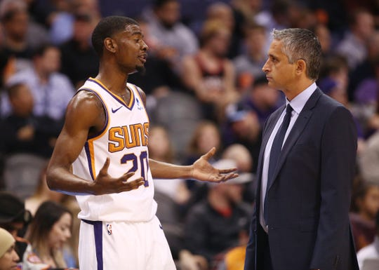 Josh Jackson talks with Suns coach Igor Kokoskov during a game against the Kings on Jan. 8 at Talking Stick Resort Arena.