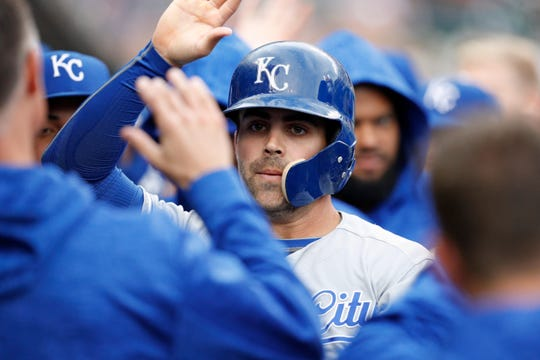 Royals second baseman Whit Merrifield  celebrates with his teammates after scoring a run against the Tigers during a game at Comerica Park.