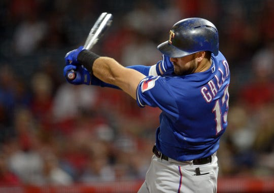 Rangers left fielder Joey Gallo hits a two-run RBI double against the Angels during a game at Angel Stadium of Anaheim.