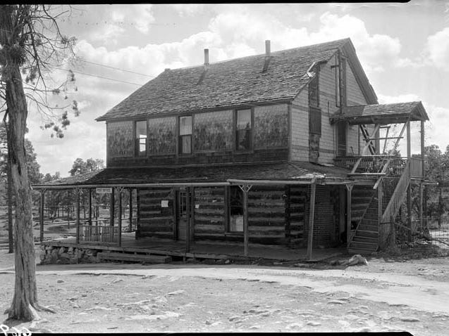 The Cameron Hotel served as a the Grand Canyon post office in 1933. The lower half survived and is part of a cabin at the Bright Angel Lodge.