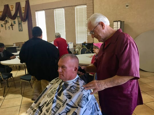 First in line for Tom Laktas' chair is Don who comes to the New Hope Community Center in Mesa every week for a high-and-tight cut like he wore in the Marine Corps.