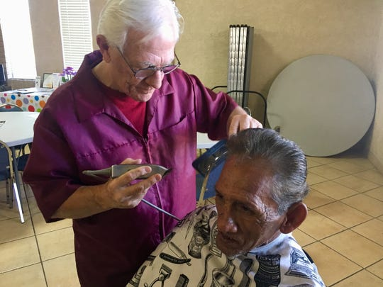 Danny comes in twice a month to get a free haircut from barber Tom Laktas at the New Hope Community Center in Mesa.