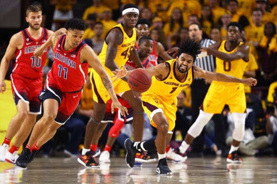 Arizona State Sun Devils guard Remy Martin (1) battles for a loose ball against Arizona Wildcats forward Ira Lee (11) in the first half at Wells Fargo Arena (AZ).