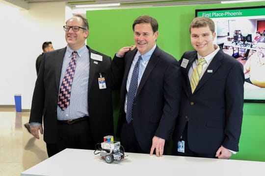 Announcement at Phoenix's First Place for program to create 500 Arizona jobs for people with autism and disabilities. Kregg Berk, who found his job at DES through the new program, Arizona Gov. Doug Ducey and Zachary Brown, who is also part of the jobs program and works at SRP.
