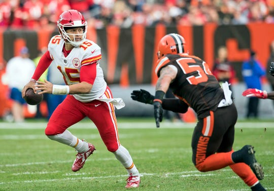 Nov 4, 2018: Kansas City Chiefs quarterback Patrick Mahomes (15) scrambles from Cleveland Browns linebacker Tanner Vallejo (54) during the second half at FirstEnergy Stadium.