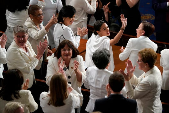 Congresswomen wearing white to honor suffragists applaud as President Donald Trump delivers his State of the Union address to a joint session of Congress on Capitol Hill in Washington, D.C., on Feb. 5, 2019.