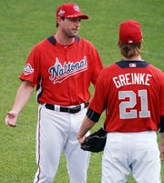 Washington Nationals pitcher Max Scherzer, left, and Arizona Diamondbacks pitcher Zack Greinke are among the highest paid players in baseball.