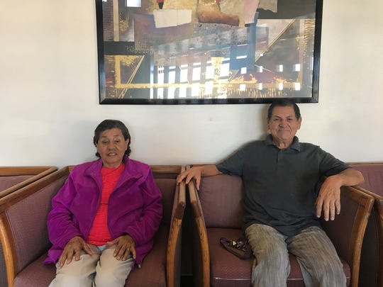 Maria Villela and her son Jose Villela sit in the lobby of Deck Park Vista. The two live in the Phoenix senior housing apartments that the city is looking to redevelop.