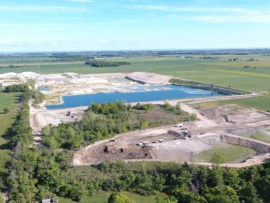 Benton Township wants to stop the application of spent lime sludge at Rocky Ridge Development's quarry, the former site of the Stoneco Quarry in Ottawa County.