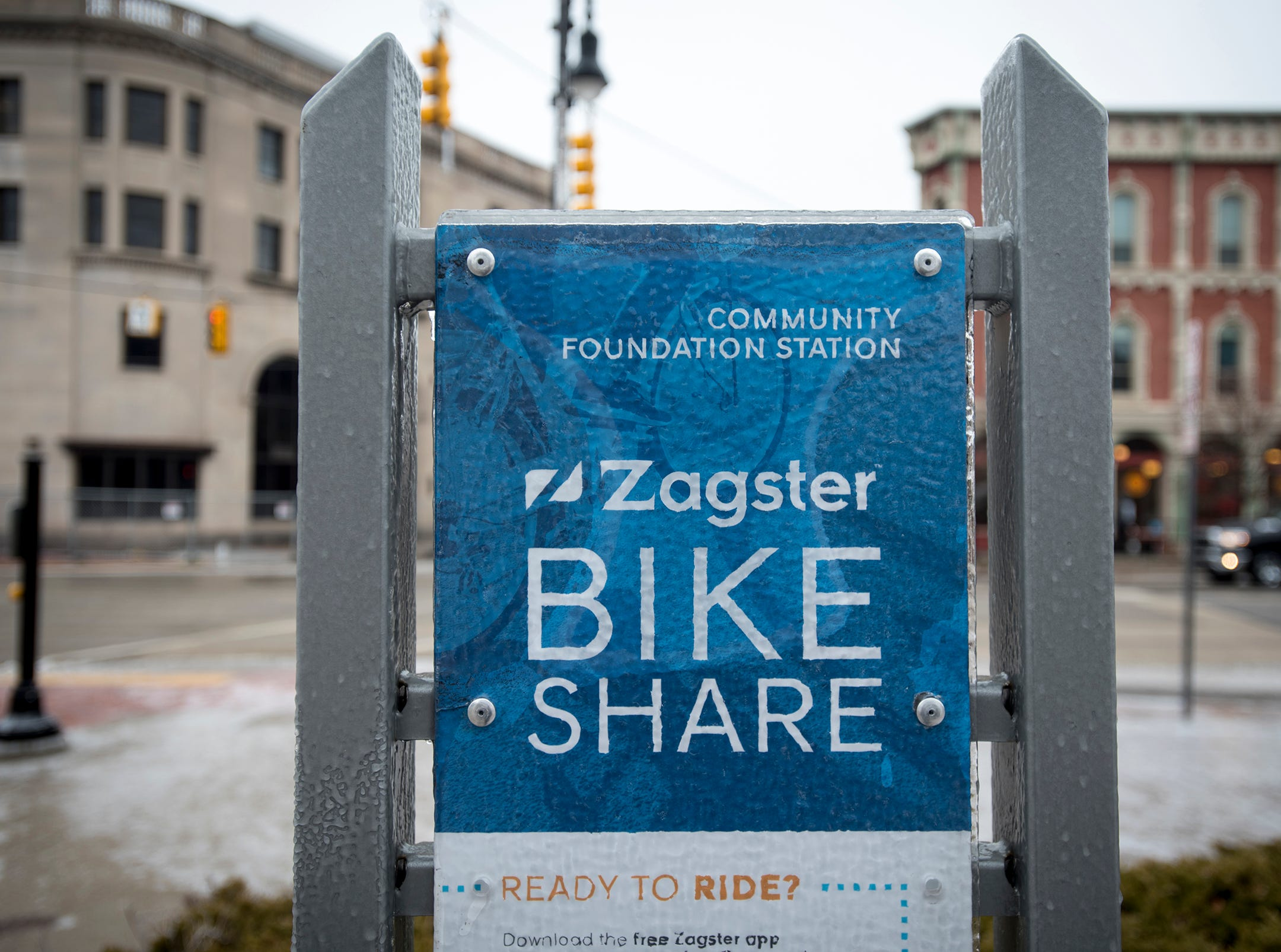 A Zagster bike kiosk is coated in ice Wednesday, Feb. 6, 2019 in downtown Port Huron.