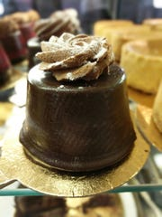 The Rhinebecker from Taste Budd's Cafe is a sponge cake soaked in coffee, filled with dark chocolate mousse and covered in a chocolate shell.