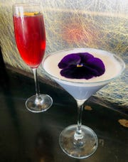 The Fleur Royale, left, made with hibiscus flower and hibiscus rooibos syrup, and the Violet's Daydream, made with lavender, crème de violette and gin, are featured cocktails at the Roundhouse in Beacon.