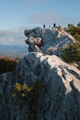 Hikers on the summit of Bonticou Crag on the Mohonk Preserve.