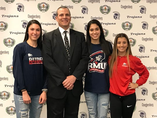 (From L-R) Soccer players Lauren Ocker, coach Ed Franchi, Gabby Lecuona and Alexandra Cottingham, joined Cole Grove, Seth Runshaw, Griffin Redding, Breanna Kratz, Alyssa Wenger and Andrew Shetter in signing their National Letters of Intent on Wednesday afternoon at Chambersburg Area Senior High School.
