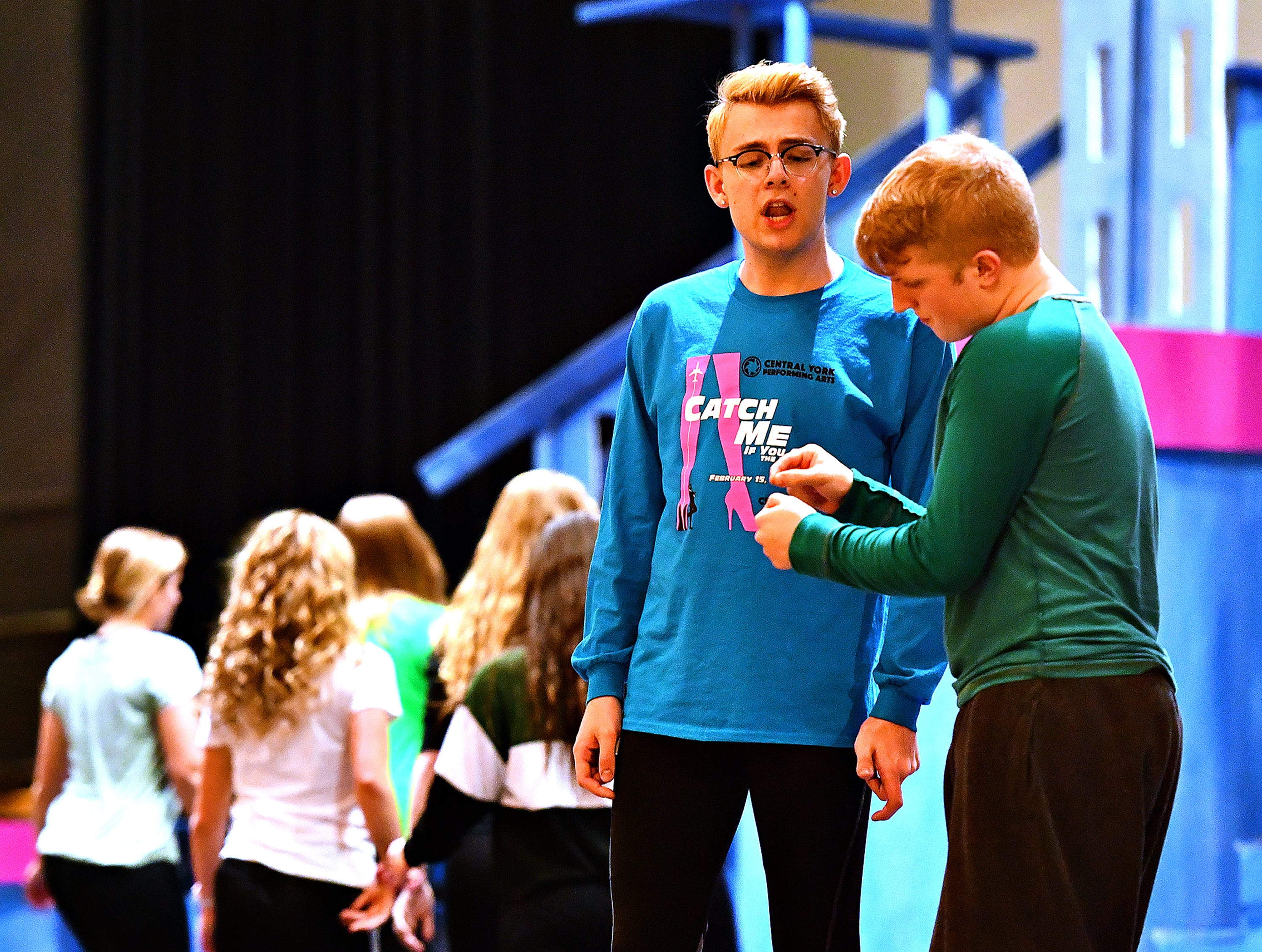 """Central York senior Koby Fink, second from right, plays Frank Abagnale, Jr., as students rehearse for their upcoming production of, """"Catch Me If You Can,"""" at Central York High School in Springettsbury Township, Wednesday, Feb. 6, 2019. Central York is the first York area school to perform the production Feb. 15-17. Dawn J. Sagert photo"""