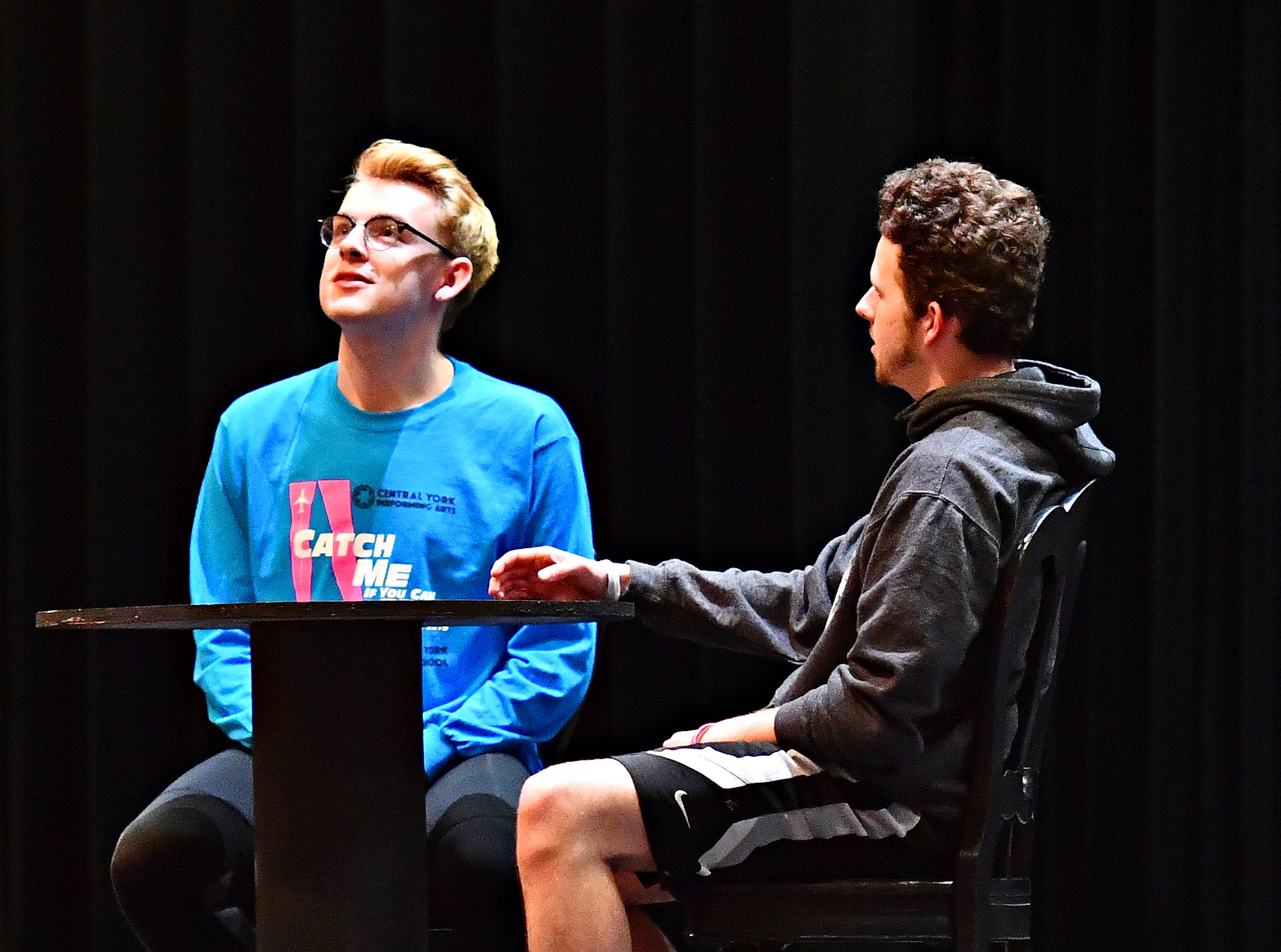 """Central York senior Koby Fink, left, plays Frank Abagnale, Jr., as students rehearse for their upcoming production of, """"Catch Me If You Can,"""" at Central York High School in Springettsbury Township, Wednesday, Feb. 6, 2019. Central York is the first York area school to perform the production Feb. 15-17. Dawn J. Sagert photo"""