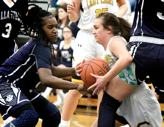 Dallastown's D'Shantae Edwards, left, and Samantha Miller stop Red LIon's Riley Miller during basketball action at Red Lion Tuesday, Feb. 5, 2019. Bill Kalina photo