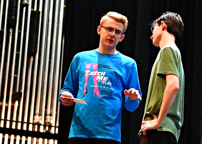 """Central York seniors Koby Fink (Frank Abagnale, Jr.,) left, and Joe Woloson (FBI Agent Carl Hanratty) share a scene as students rehearse for their upcoming production of, """"Catch Me If You Can,"""" at Central York High School in Springettsbury Township, Wednesday, Feb. 6, 2019. Central York is the first York area school to perform the production Feb. 15-17. Dawn J. Sagert photo"""