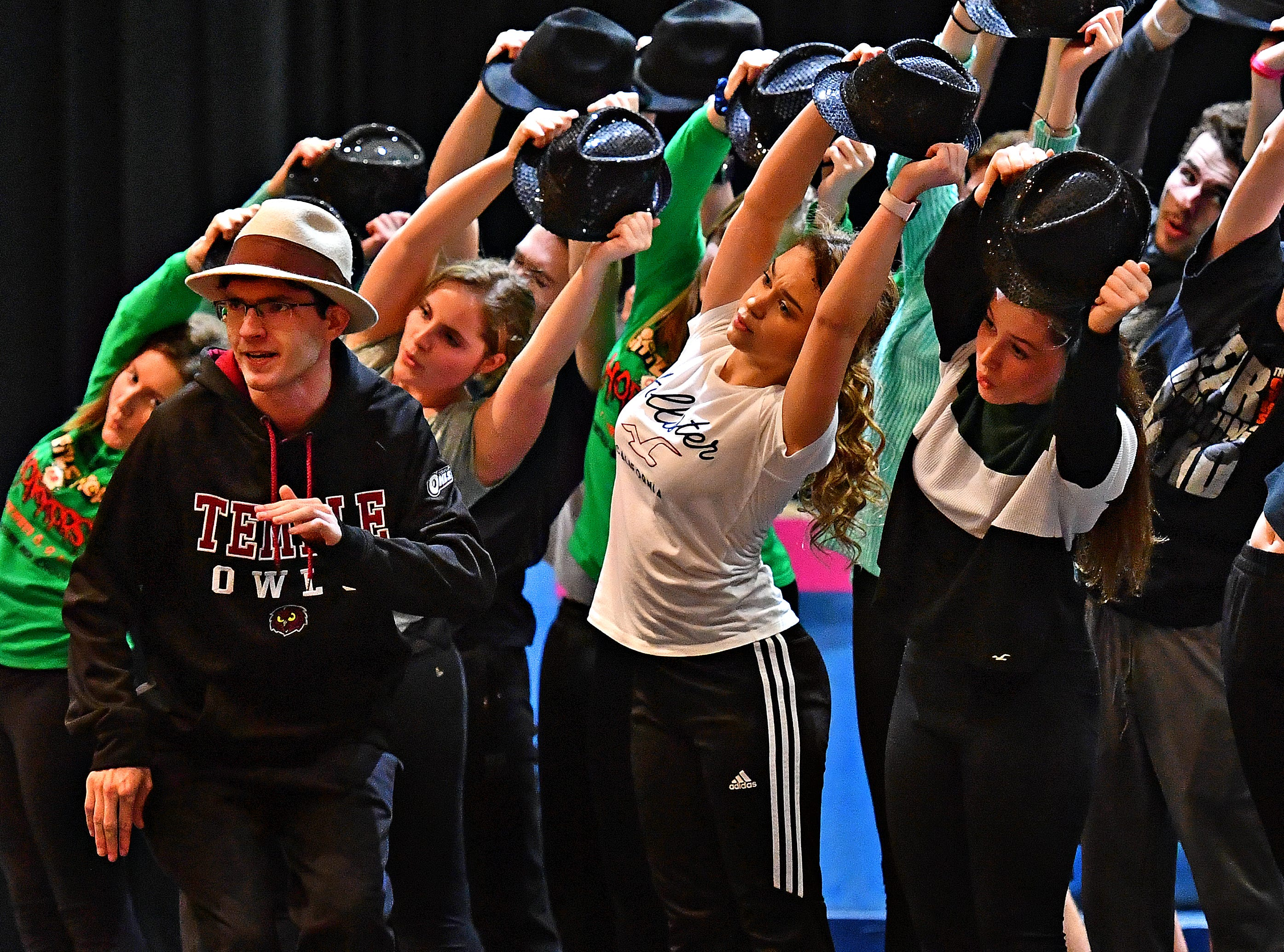 """Central York senior Joe Woloson, front left, plays FBI agent Carl Hanratty as students rehearse for their upcoming production of, """"Catch Me If You Can,"""" at Central York High School in Springettsbury Township, Wednesday, Feb. 6, 2019. Central York is the first York area school to perform the production Feb. 15-17. Dawn J. Sagert photo"""