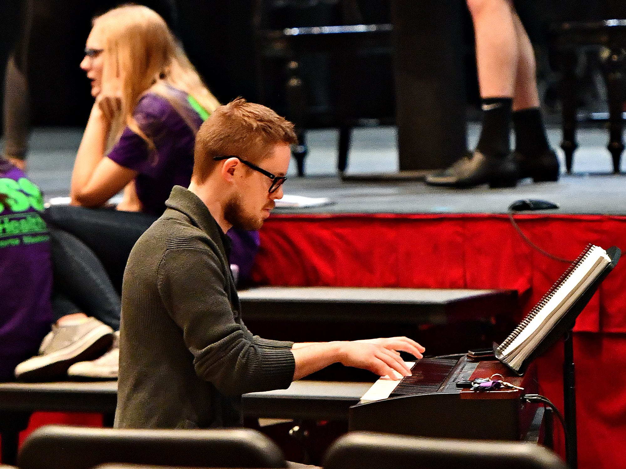 """Musical accompanist Matt Schriver plays keyboard while Central York High School students rehearse for their upcoming production of, """"Catch Me If You Can,"""" at Central York High School in Springettsbury Township, Wednesday, Feb. 6, 2019. Central York is the first York area school to perform the production Feb. 15-17. Dawn J. Sagert photo"""