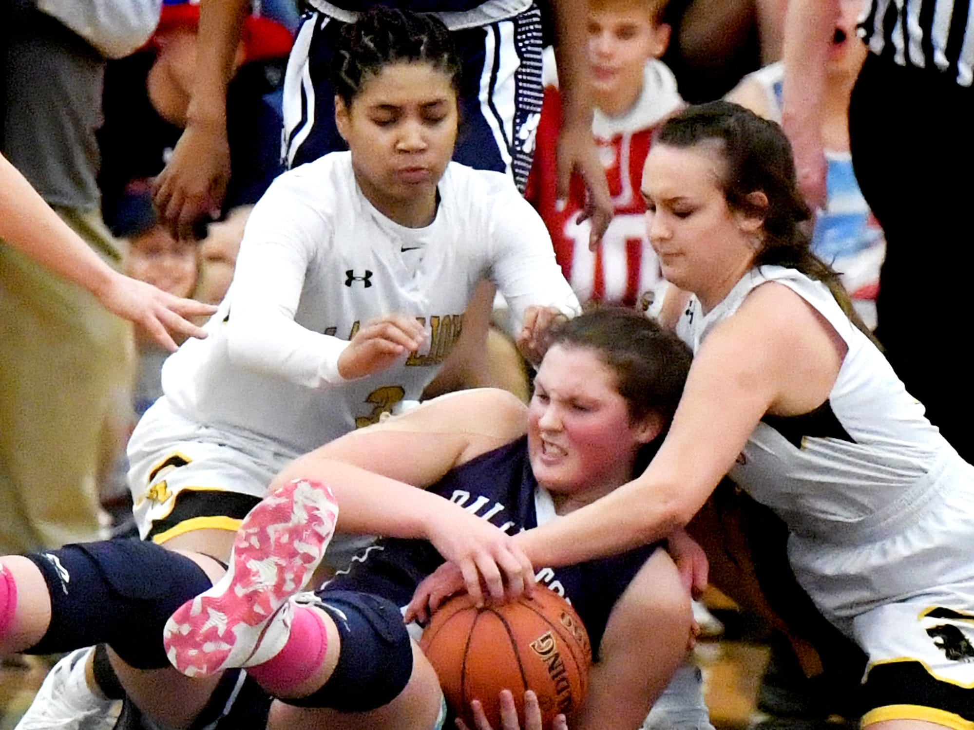 Red LIon's Asia Eames, left, and Riley Miller fight for possession with Dallastown's Samantha Miller during basketball action at Red Lion Tuesday, Feb. 5, 2019. Bill Kalina photo