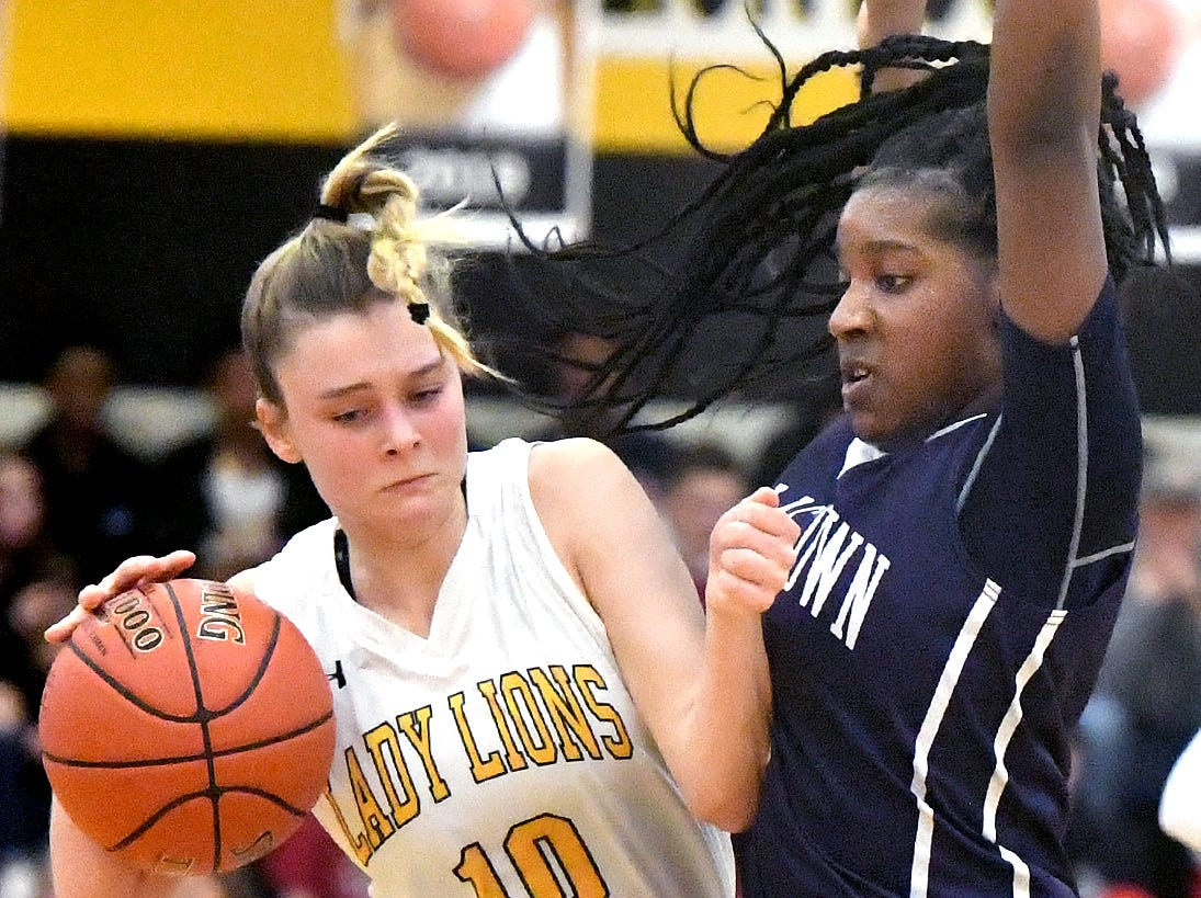 Dallastown's D'Shantae Edwards defends Red LIon's Alleney Klunk during basketball action at Red Lion Tuesday, Feb. 5, 2019. Bill Kalina photo