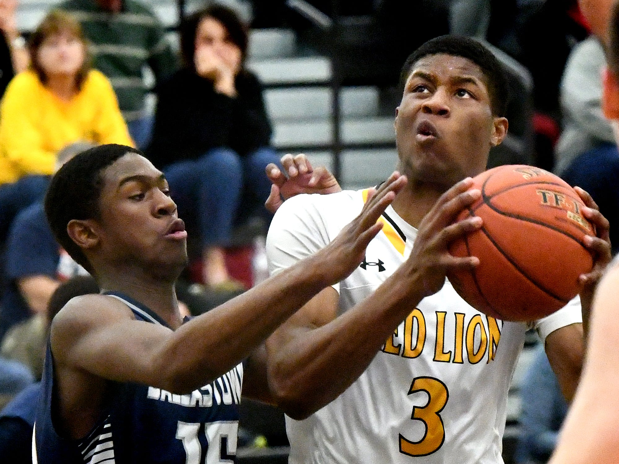Red Lion's Davante Dennis drives against Dallastown's Jadon Green during basketball action at Red Lion Tuesday, Feb. 5, 2019. Bill Kalina photo