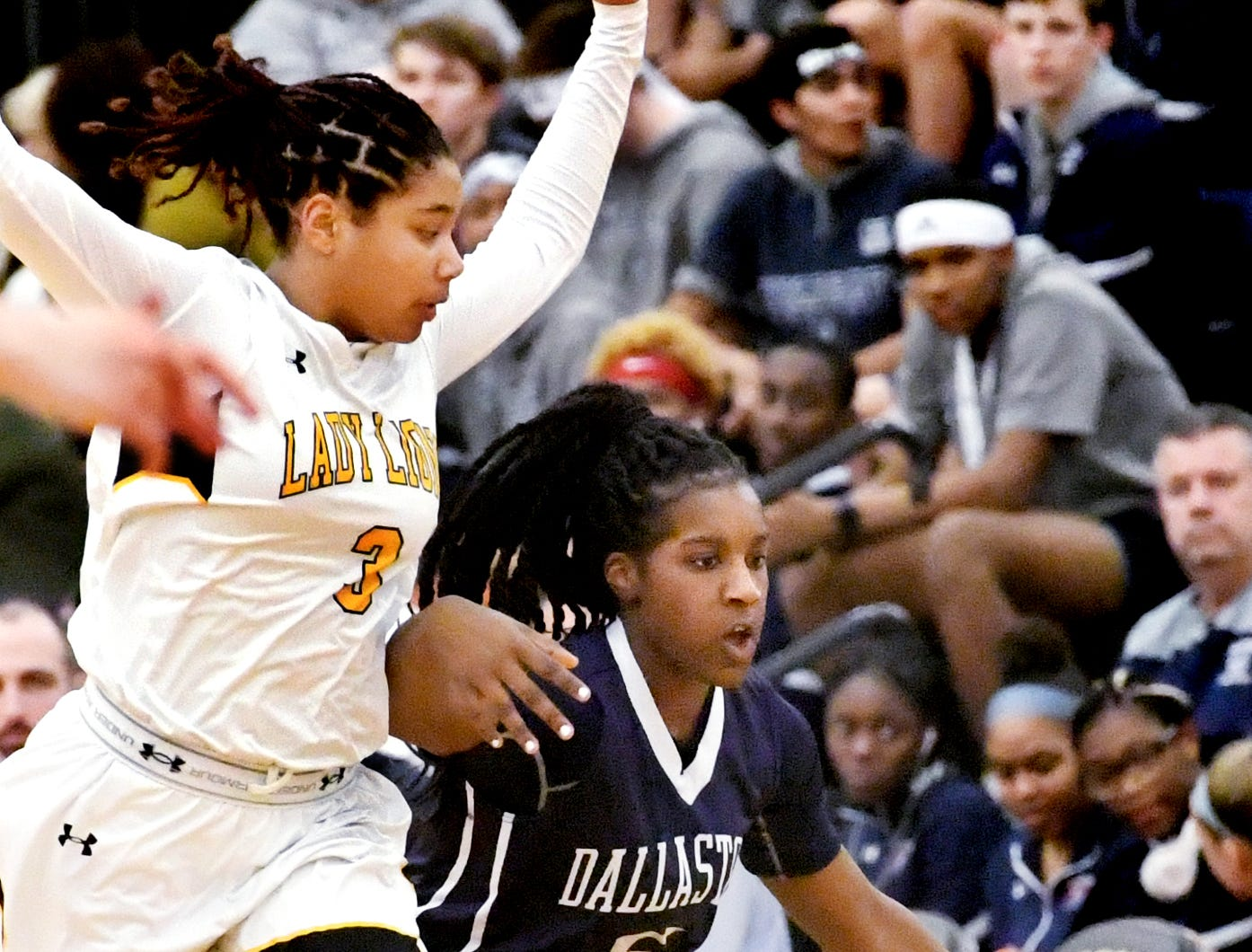 Dallastown's D'Shantae Edwards drives with pressure from Red LIon's Asia Eames during basketball action at Red Lion Tuesday, Feb. 5, 2019. Bill Kalina photo