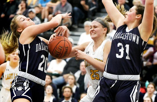 Dallastown's Lily Jamison, left, and Samantha Miller fight for a rebound with Red LIon's Julia Beiler during basketball action at Red Lion Tuesday, Feb. 5, 2019. Bill Kalina photo