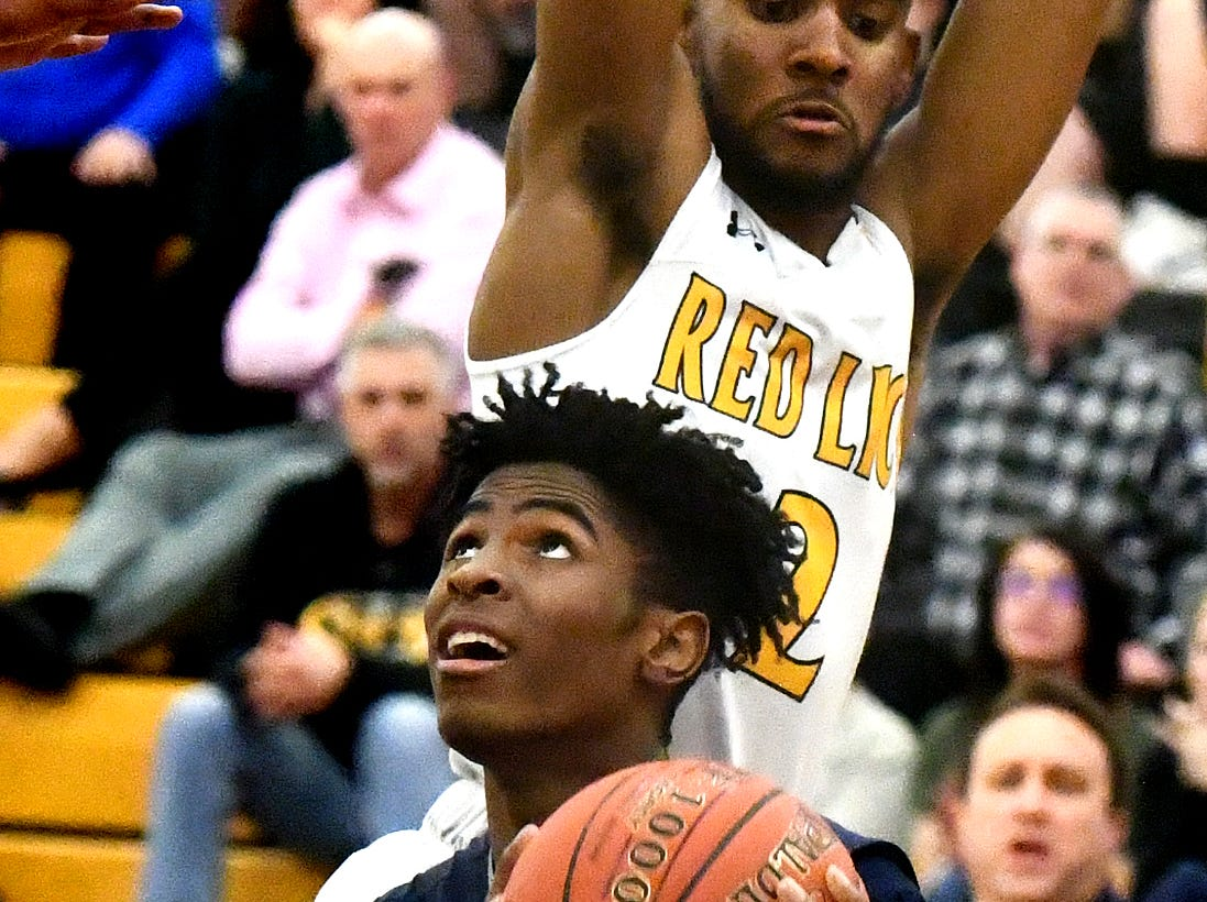 Dallastown's Kobe Green eyes the hoop with Red LIon's Phillip Douglass defending during basketball action at Red Lion Tuesday, Feb. 5, 2019. Bill Kalina photo
