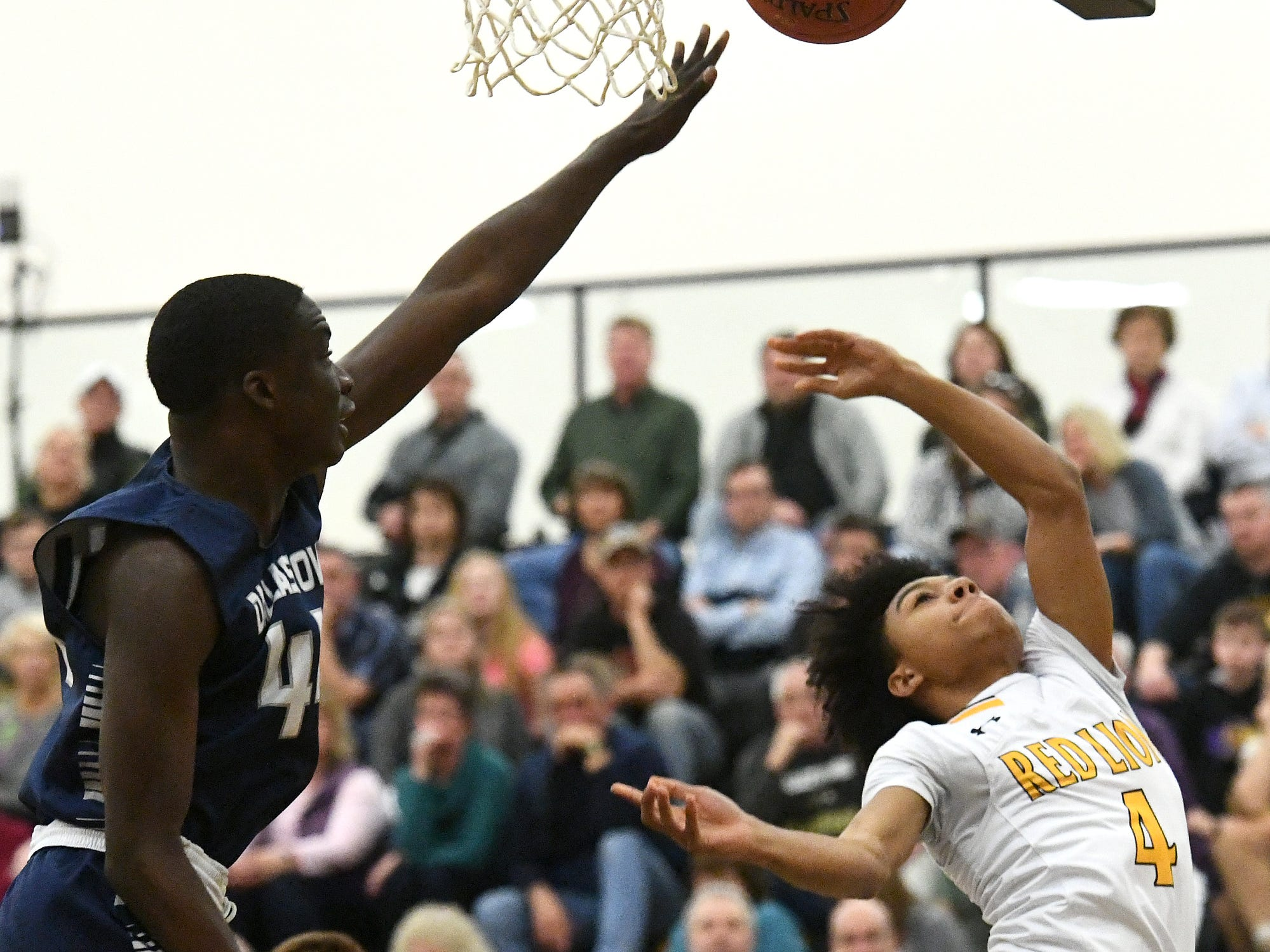 Red Lion's Cameron Lindsay throws up a shot with Dallastown's Leke Ogunnupe defending during basketball action at Red Lion Tuesday, Feb. 5, 2019. Bill Kalina photo