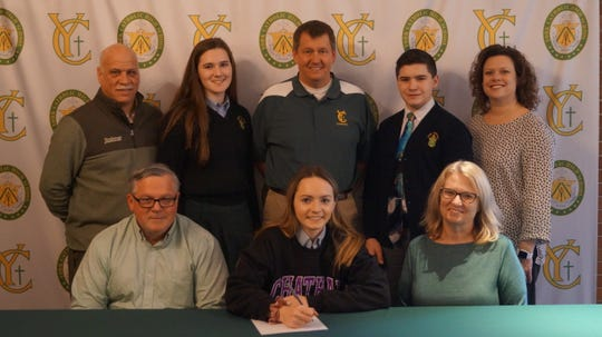 York Catholic senior Phallon Kilduff signs her letter of intent to play lacrosse at Chatham University.