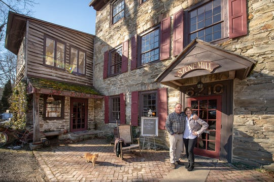 Joe and Pam Hepner stand in front of the Stone Mill 1792 in Manheim Township. The Hepners, who bought the property in 2012, hope to sell it to someone who wants to continue a wedding and event business there.